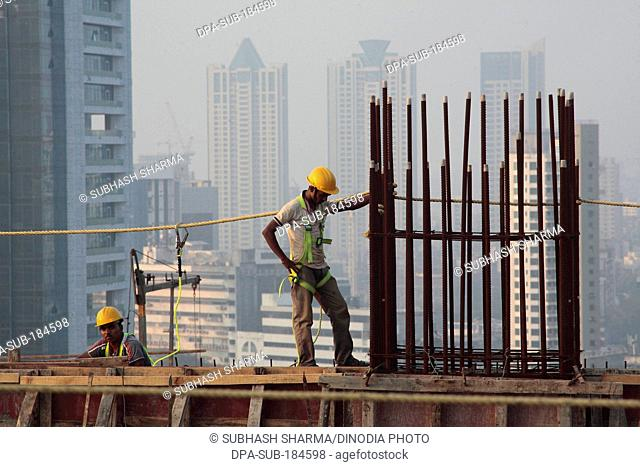 Construction workers working highrise at lower parel Mumbai India