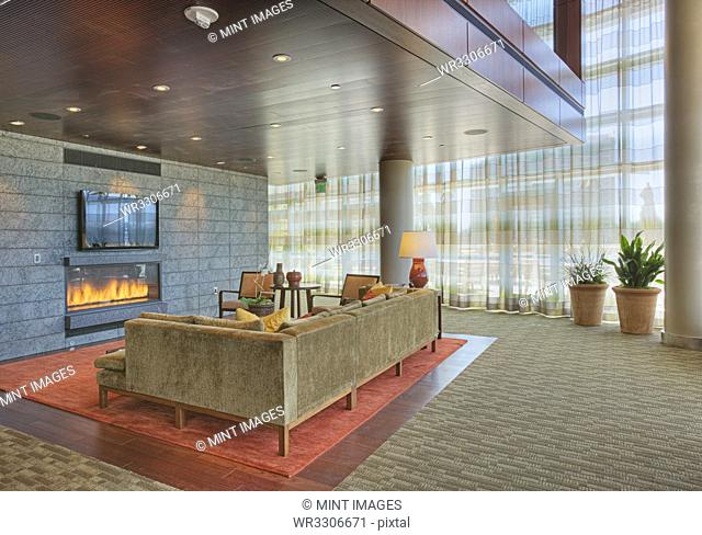 Sofa and fireplace in lobby