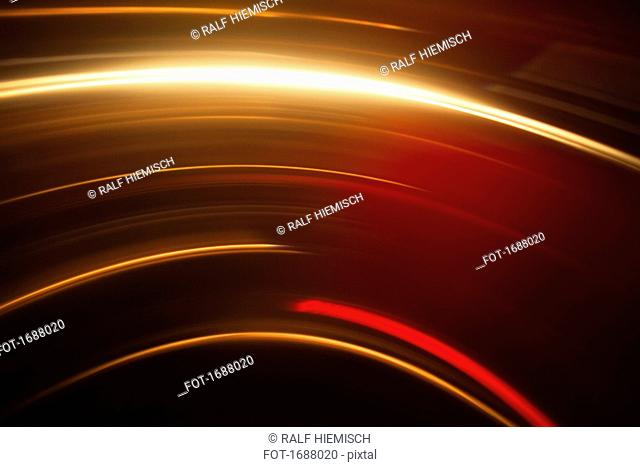 Abstract image of vibrant light trails against black background