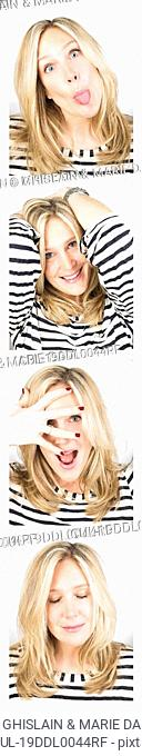 Young woman having fun in a photo booth