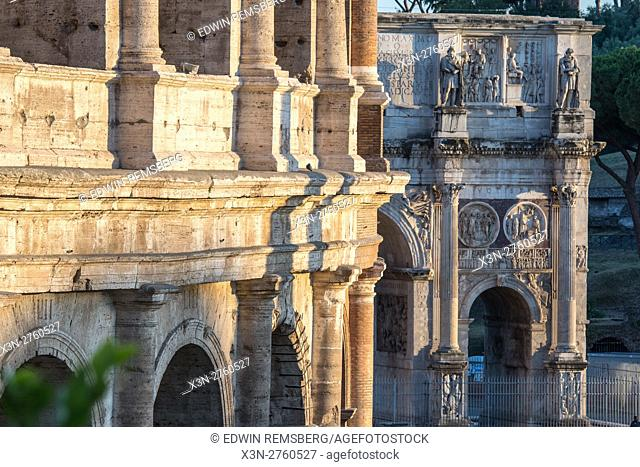 Rome, Italy- View of the famous stone amphitheater known as the Roman Colosseum with The Arch of Constantine in the background, located east of the Roman Forum