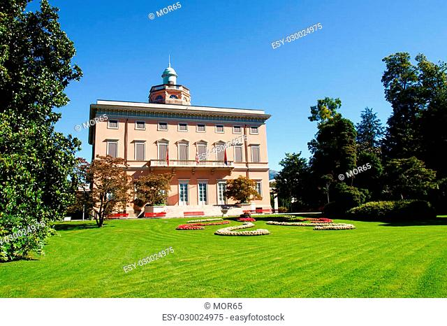 Lugano, Switzerland - Juli 31, 2014: Images of the Gulf of Lugano and Ciani park, botanical park of the city. The Old House in the park Villa Ciani