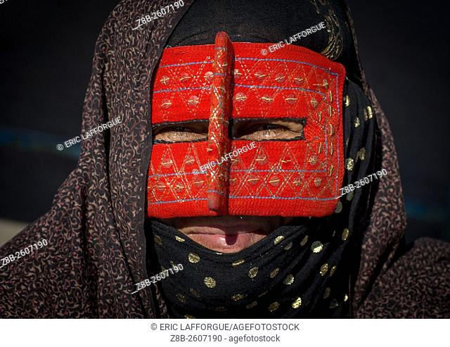 Iran, Hormozgan, Bandar Abbas, a bandari woman wearing the traditional mask called the burqa on a market