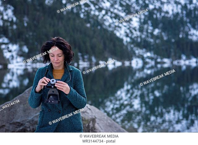 Woman reviewing picture on digital camera