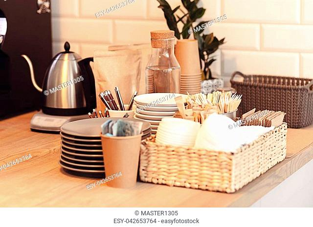 A table setting on the counter at a coffee house