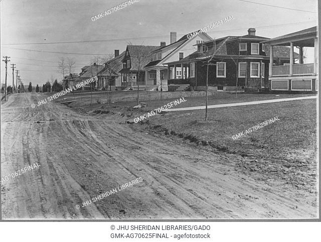 Street-level shot of two-story brick houses along a dirt road houses spaced out, no tall trees, Roland Park/Guilford, United States, 1910