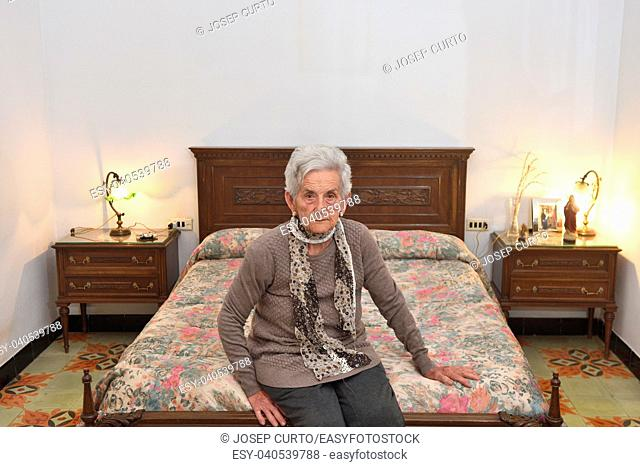 portrait of an elderly woman in a bedroom
