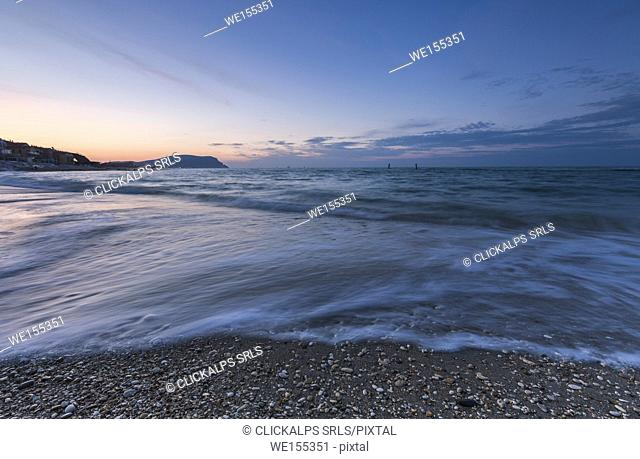 Waves crashing on the beach framed by the blue dusk Porto Recanati Province of Macerata Conero Riviera Marche Italy Europe