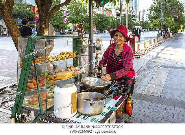Vietnamese woman selling fast food from a street kitchen, Ho Chi Minh City, Saigon, Vietnam, Asia