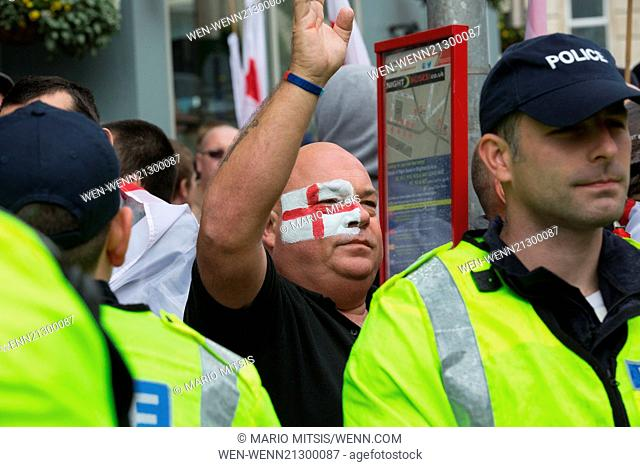 Annual St. George's day march along Brighton sea-front by right wing groups EDL and MFE. They were opposed by locals and members of Antifa and UAF