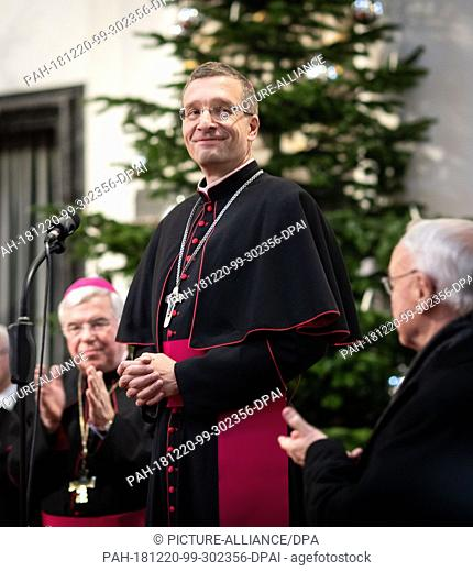 20 December 2018, Hessen, Fulda: The recently newly appointed bishop of Fulda, Michael Gerber (M), stands in the cathedral between the diocesan administrator...
