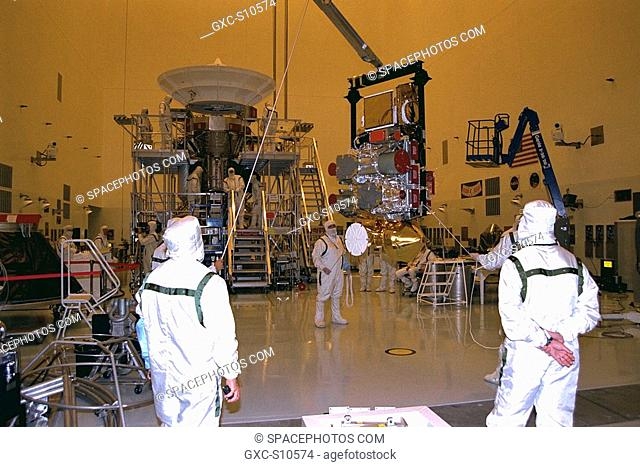 07/08/1997 --- Technicians from the Jet Propulsion Laboratory JPL of the California Institute of Technology lift the remote sensing pallet in the Payload...