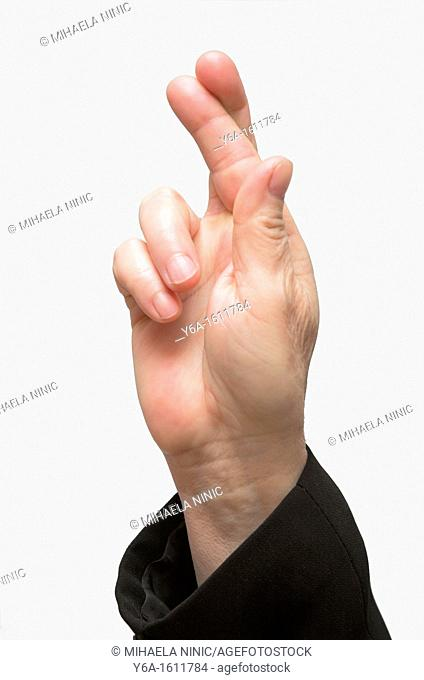 Businesswoman's hand with fingers crossed, close-up