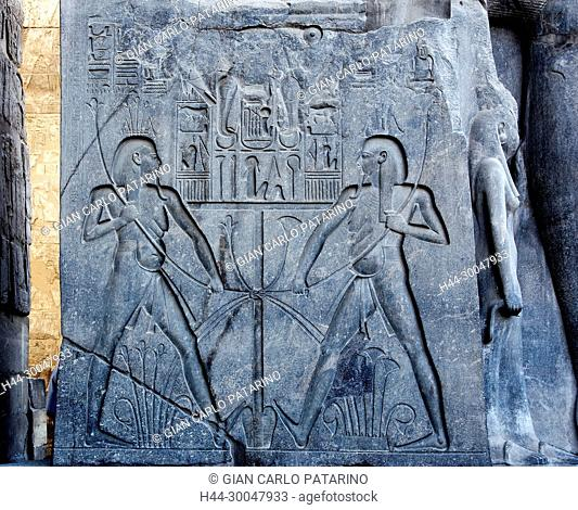 Luxor, Egypt. Temple of Luxor: relief on the base of the giant statue of the pharaoh Ramses II