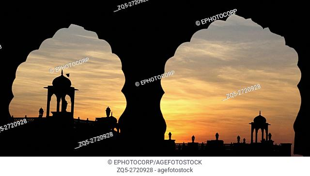 Silhouette of temple with sun setting in the background. Raigad district, Maharashtra India