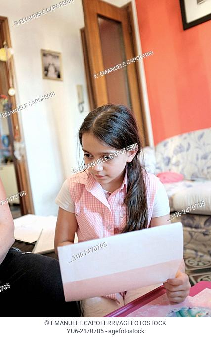 Portrait of little girl with homework