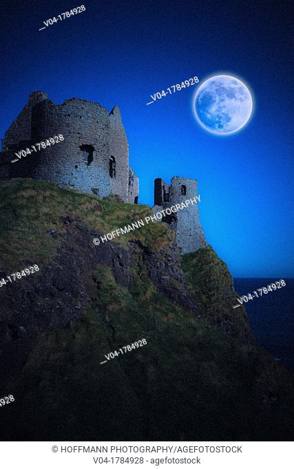 Full moon over the ruins of Dunluce Castle, Norhtern Ireland, Europe