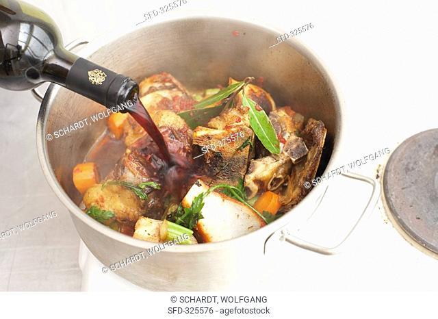 Deglazing sautéd bones and vegetables with red wine