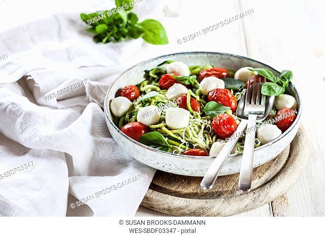 Zoodles Caprese, spiralized zucchini, glass noodles, pesto, plum tomatoe, mozarella balls