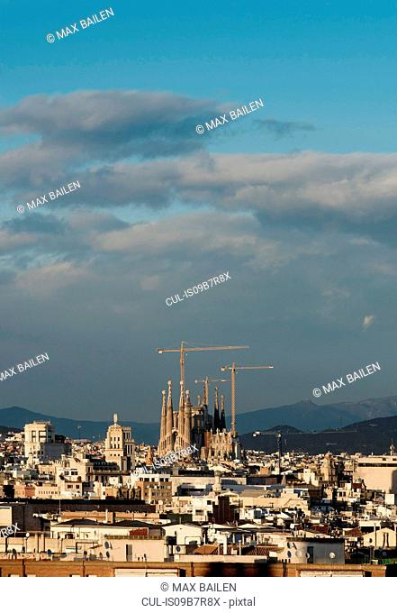 Cityscape view with Sagrada Familia and construction cranes, Barcelona, Spain