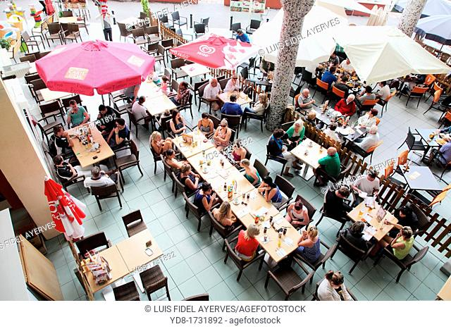 Tourists drinking at a restaurant in Puerto Marina, Benalmadena, Malaga province, Costa del Sol, Andalucia, Spain, Europe
