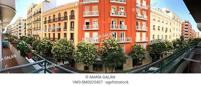 Facades of houses, panoramic view. Lope de Rueda street, Madrid, Spain