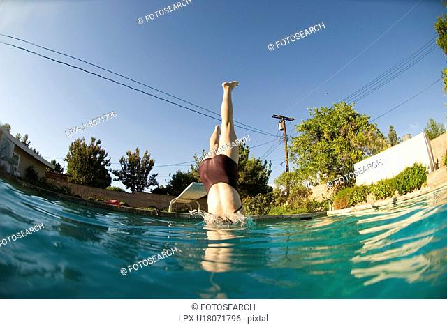 A female diving into a pool