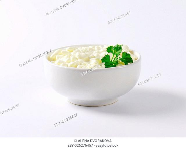 bowl of cottage cheese with fresh parsley