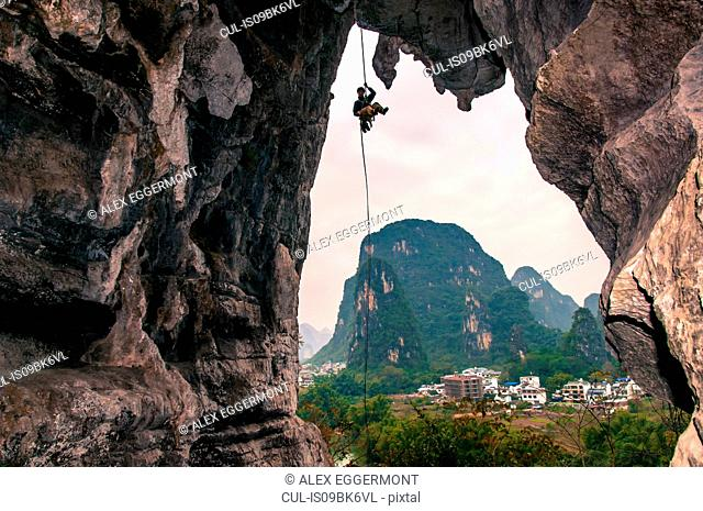 Sport climbing on limestone, in Yangshuo, Guangxi, China
