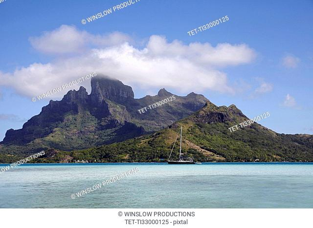 Sailboat with islands at background