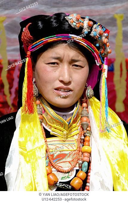Tibetan traditional clothes at a wedding. Danba. Sichuan
