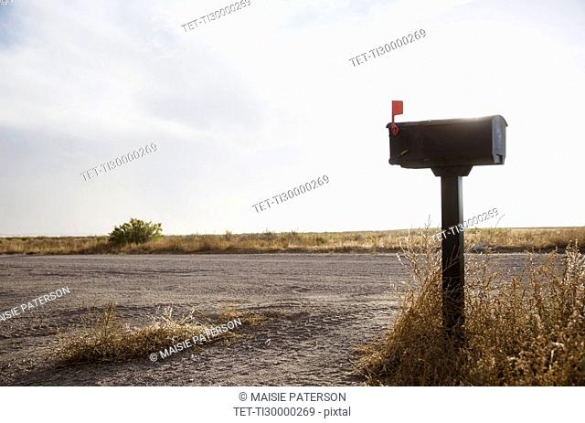 Mailbox by empty dirt road
