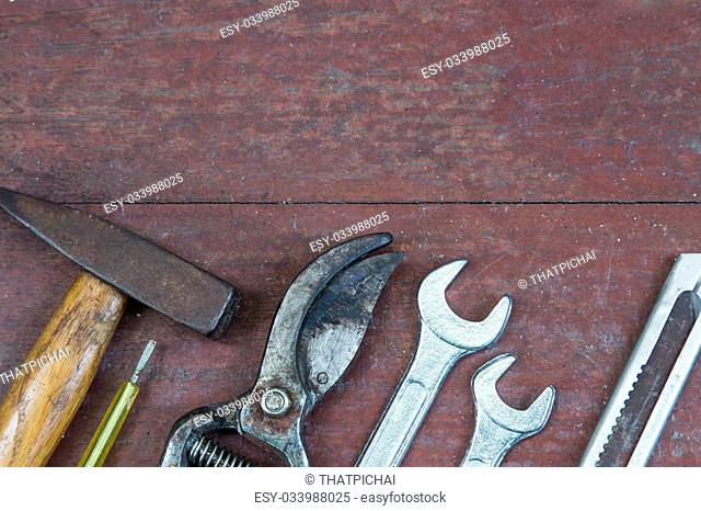 Set of tools on wooden panel with space for text