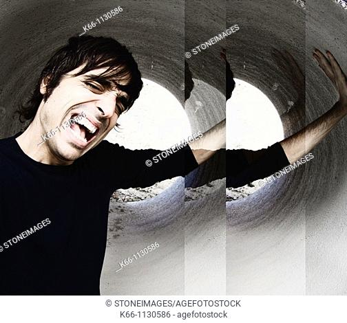 Man crying in a tube