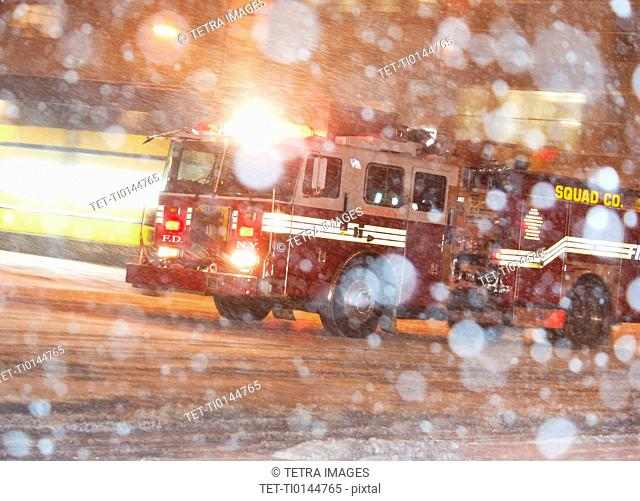 USA, New York City, Fire engine in blizzard