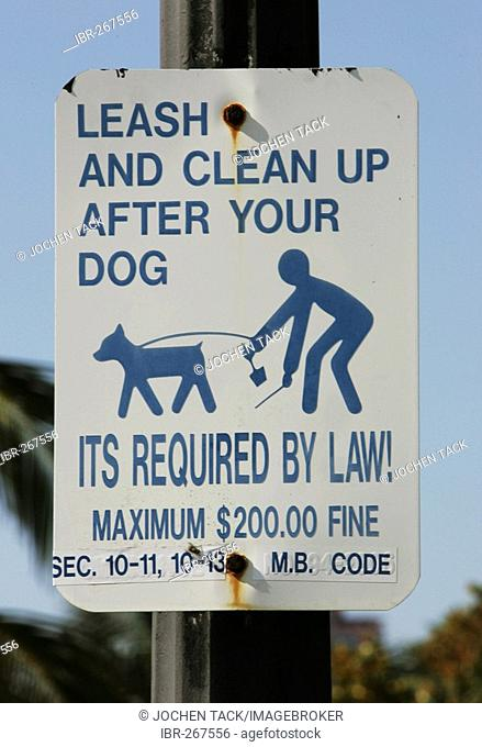 Signpost for dog owners to clean after their dog, Miami Beach, Florida, USA
