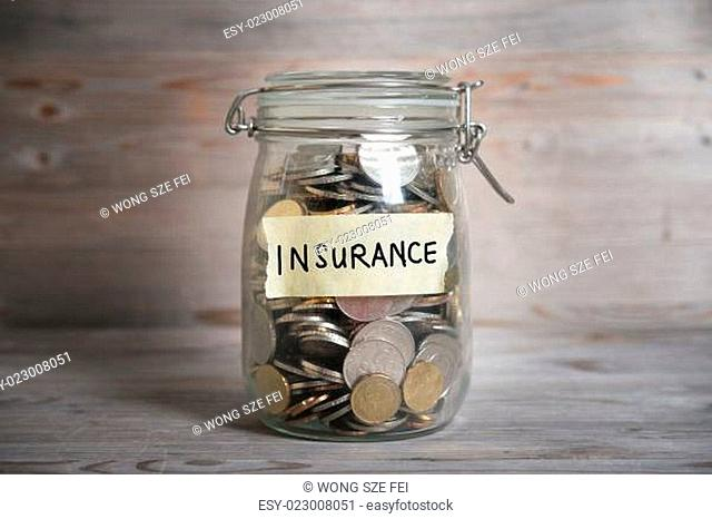 Coins In Jar With Insurance Label