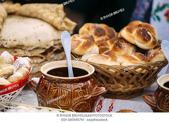 The dishes of the traditional Belarusian cuisine - fresh pastries and honey