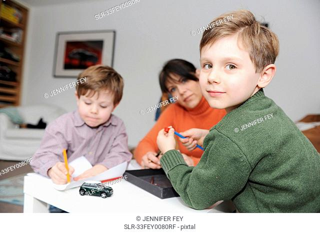 Mother and children drawing together
