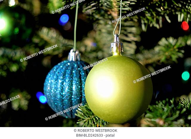 Blue and green ornaments hanging on Christmas tree