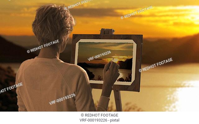 Dolly shot woman painting landscape picture in sunset