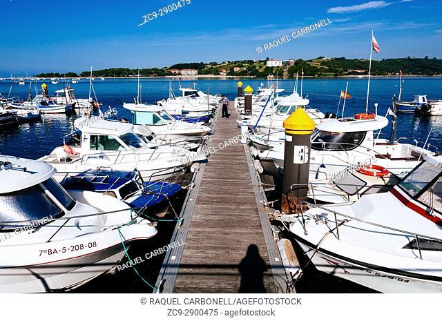 Boats moored in a little port, San Vicente de la Barquera, Cantabria, Spain
