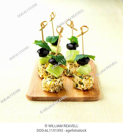 Fennel-marinated feta and olive skewers, canape