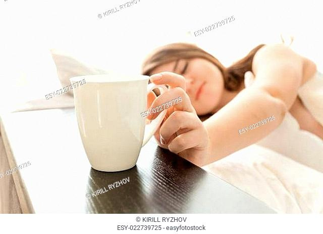 beautiful woman taking cup of coffee at bed