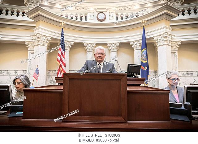 Caucasian politician giving speech in capitol building