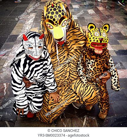 A man and two children dressed as jaguars during the annual pilgrimage to the Our Lady of Guadalupe basilica in Mexico City, Mexico