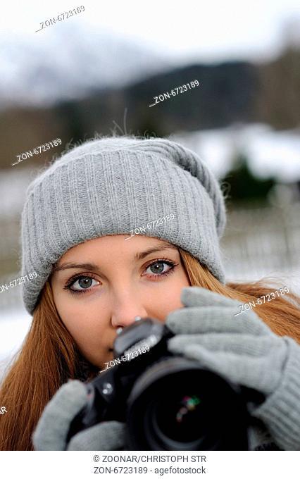 Female with digital camera