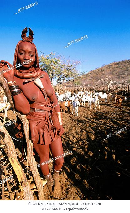 Himba wife with the goats. Kaokoveld. Namibia