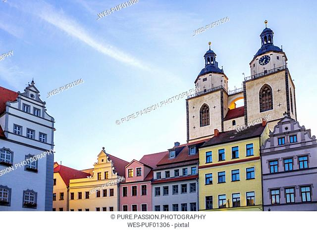 Germany, Lutherstadt Wittenberg, view to town hall, row of houses and St Mary's Church in the background
