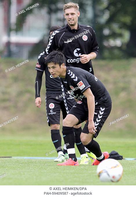 St. Pauli's Lasse Sobiech (back) watches his teammate Ryo Miyaichi (R) during the kick-off training session of German second division Bundesliga soccer club...